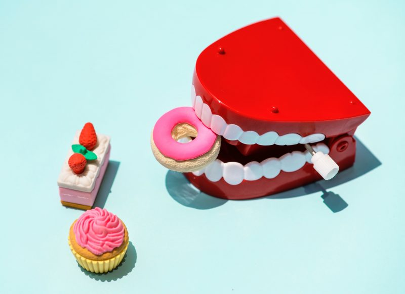National Dentist Day Teeth image with treats - March Content Calendar Ideas + Templates
